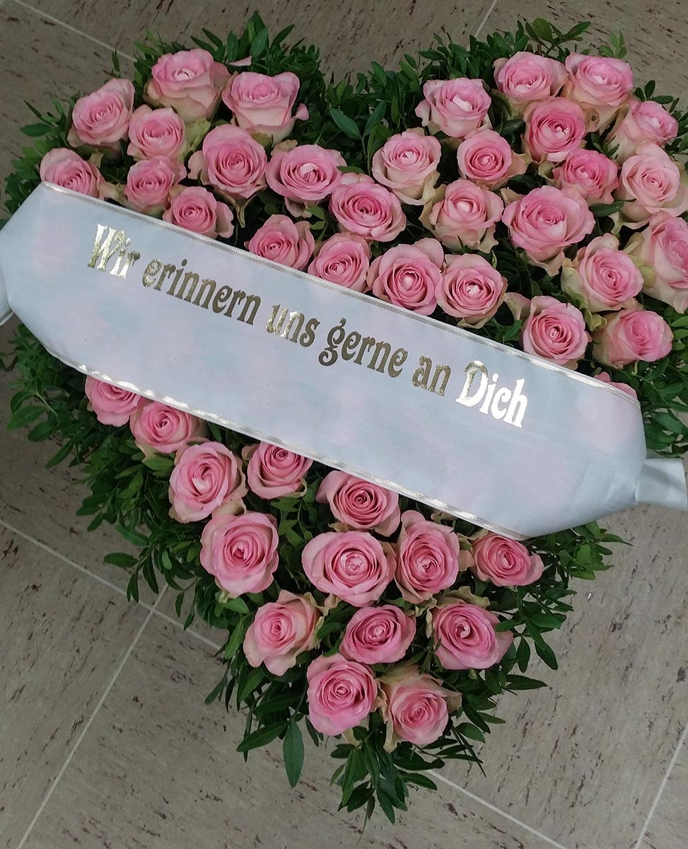 Grab Gesteck rosa Rosenherz